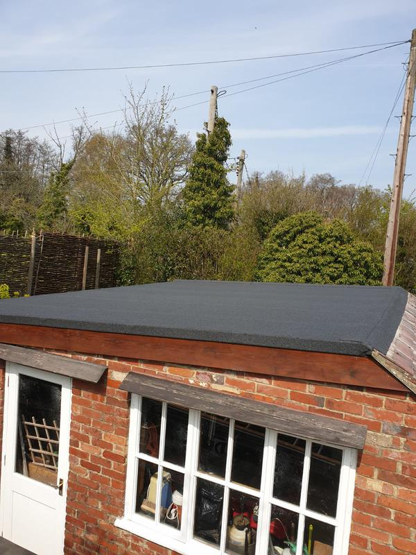 Image 5 - Flat roof garage in 3 layer torch on system with a charcoal mineral finish