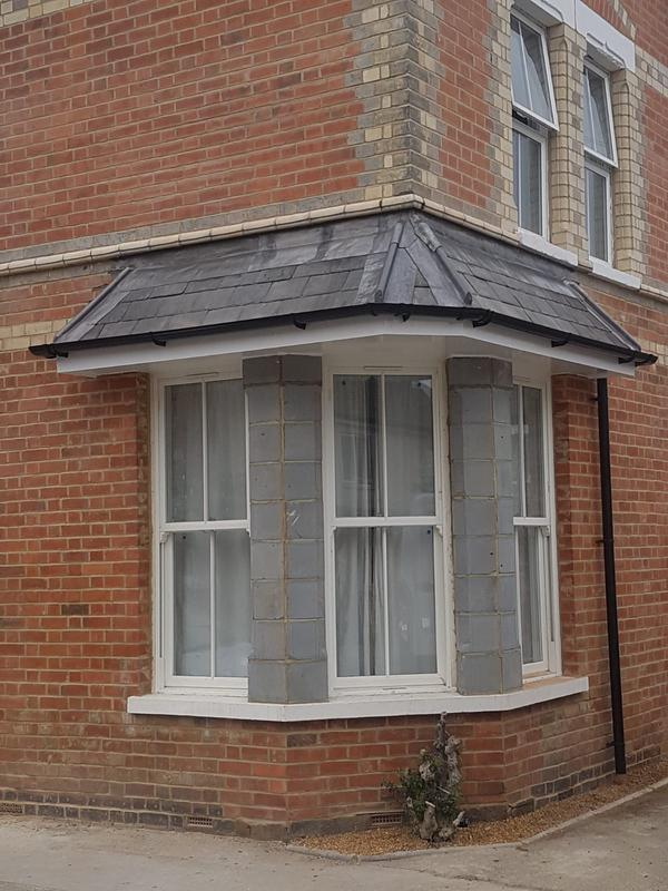 Image 49 - Slate bay window with lead hips and abatement flasings