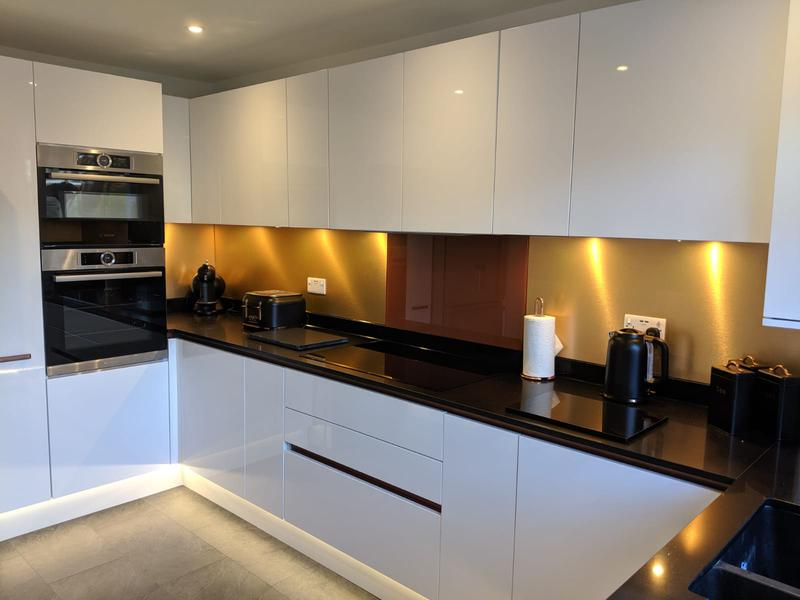 Image 5 - Gloss with C-Channel Handles from Italy also has Copper Splash-Backs with Copper glass over the Hob,under counter lights and plinth lighting.