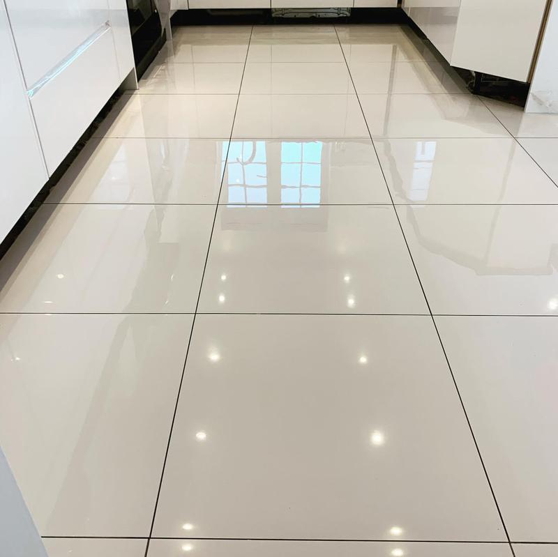 Image 98 - 50 m2 white polished porcelain tiles fitted in Solihull