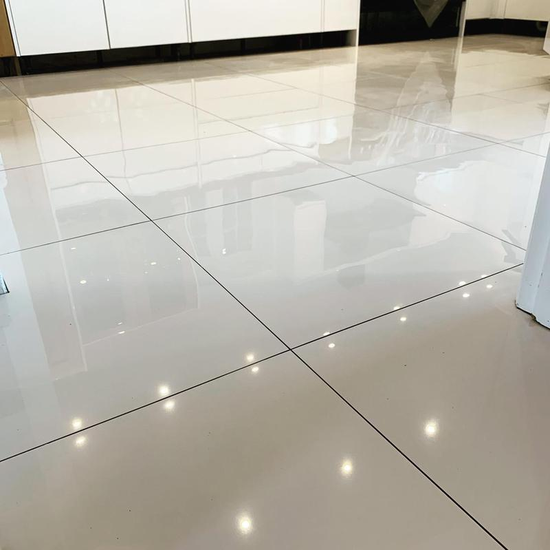 Image 92 - 50 m2 white polished porcelain tiles fitted in Solihull