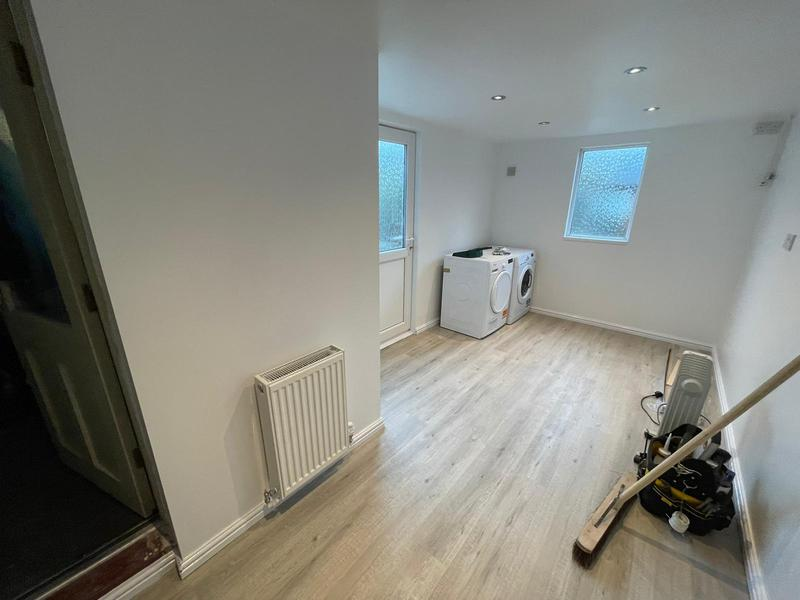 Image 12 - Full garage conversion including removal of partitioning walls, batten and board, plaster, decoration, new floor, new radiator