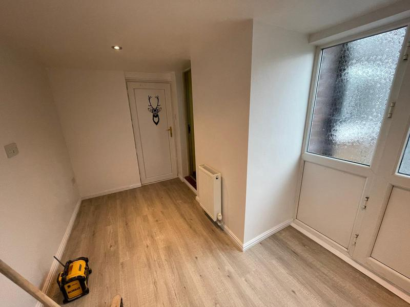 Image 11 - Full garage conversion including removal of partitioning walls, batten and board, plaster, decoration, new floor, new radiator