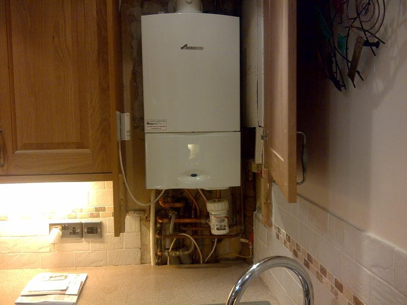 Image 1 - Boiler change to a Worcester Greenstar Combi Boiler within kitchen cupboard