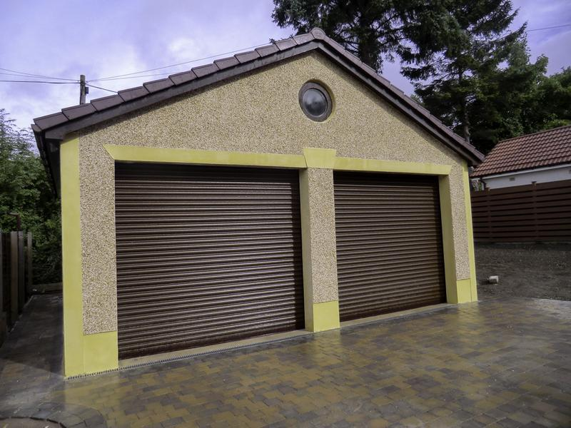 Image 22 - Some nice smooth band render added to this double garage adds a striking feature .