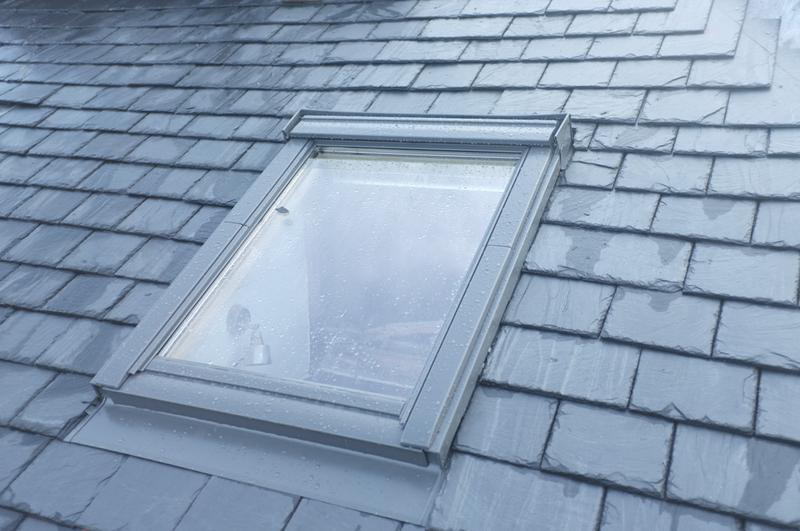 Image 5 - A new Velux fitted to this Slated roof adds light to a loft conversion
