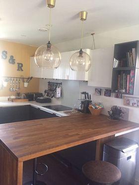 Image 5 - Kitchen oak breakfast bar and new kitchen under cupboards.