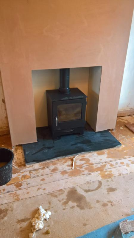 Image 23 - jydepejsen stove with twin wall flue system into false chimney