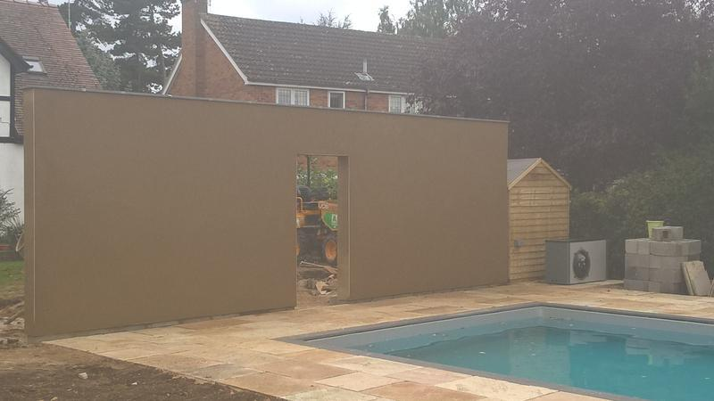 Image 5 - Rendered wall next to swimming pool (Raunds)