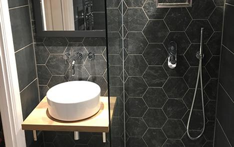 Image 23 - Patterned wall tiles and a glamorous round basin and a walk n shower.