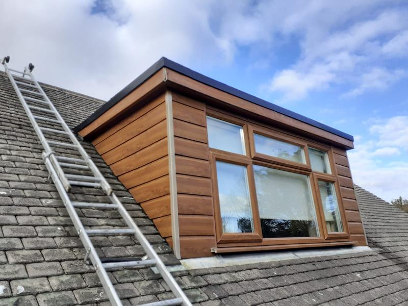 Image 12 - Flat roof dormer finished with roof trims