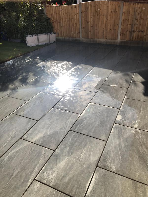 Image 43 - Porcelain tiled patio, washed and ready for pointing in black.