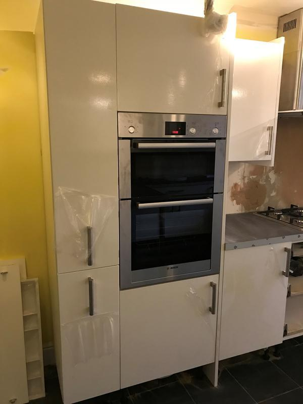 Image 24 - High gloss 300mm pull out storage with lader unit which oven is situated next to it